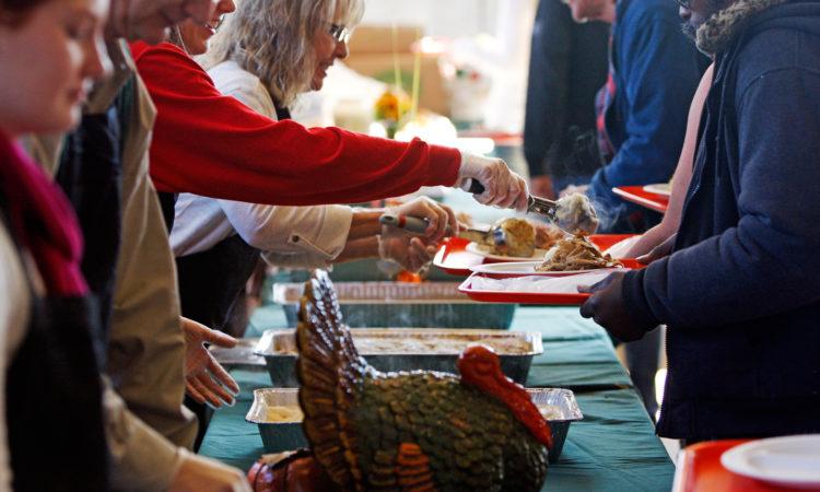 Volunteers help serve Thanksgiving meals