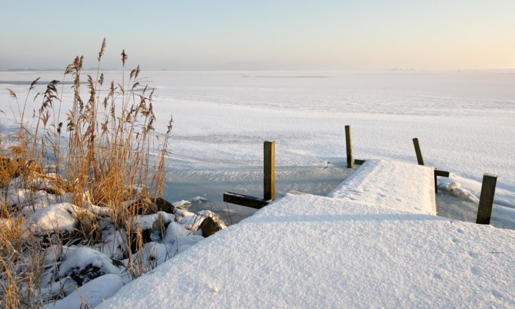 snow-covered-beach-walkway-
