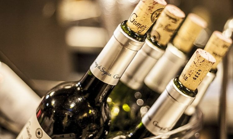 white-labeled-bottles-with-corks-bottles-of-wine