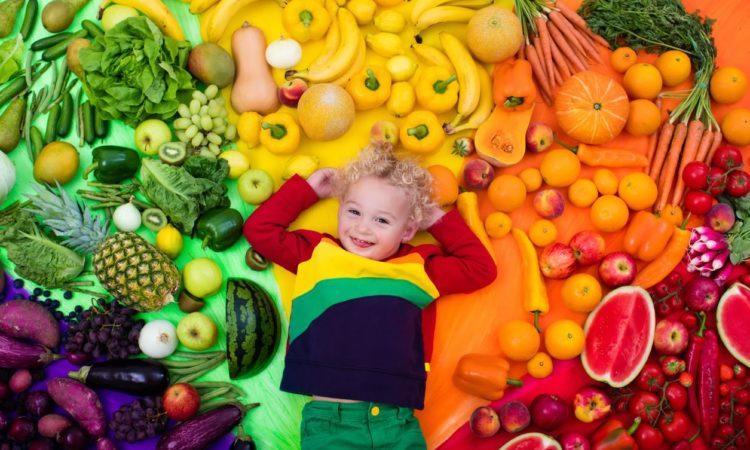 boy enjoying the rainbow-